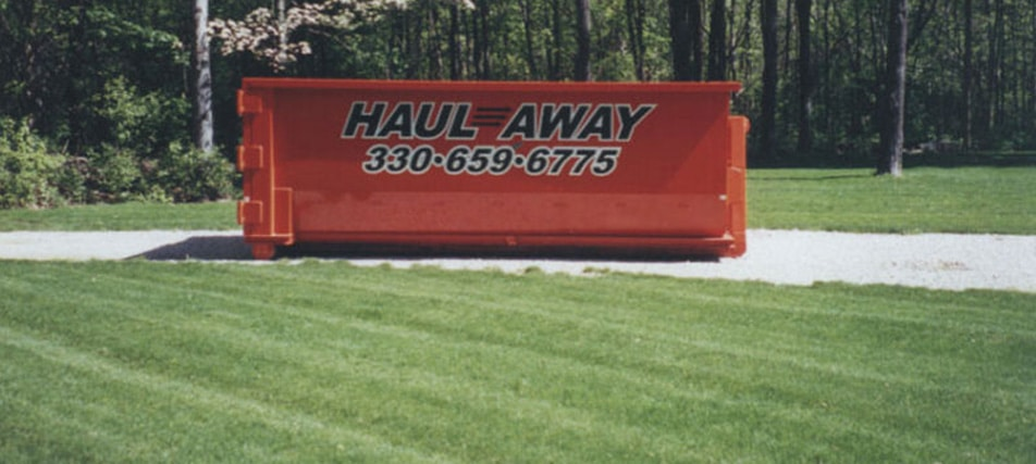 Rental Dumpster, Distant Orange Container Image - Haul-Away